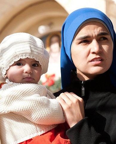 Woman-and-child-outside-parish-church-in-Gaza.jpg