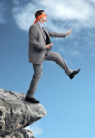 man-stepping-off-cliff.jpg